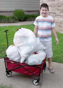 LITTLE BOY WITH TRASH BAGS